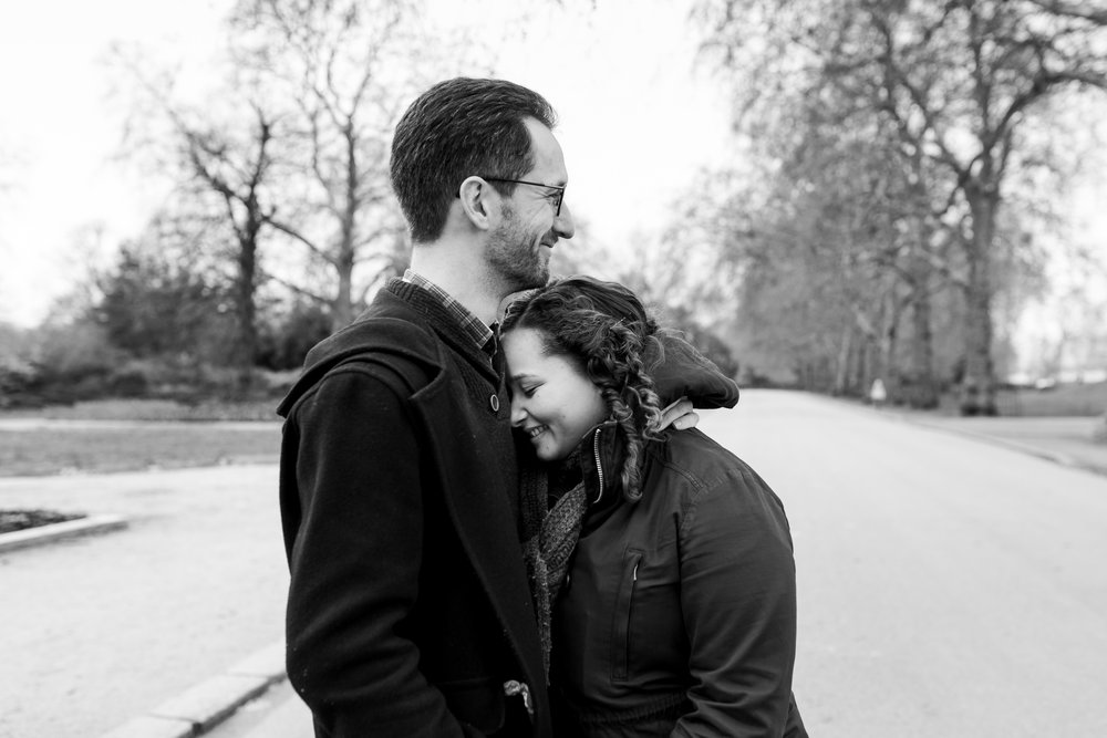 couple snuggling in pre-wedding photography battersea park