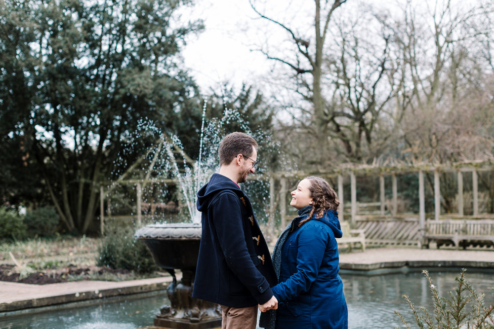 couple by fountain in london park