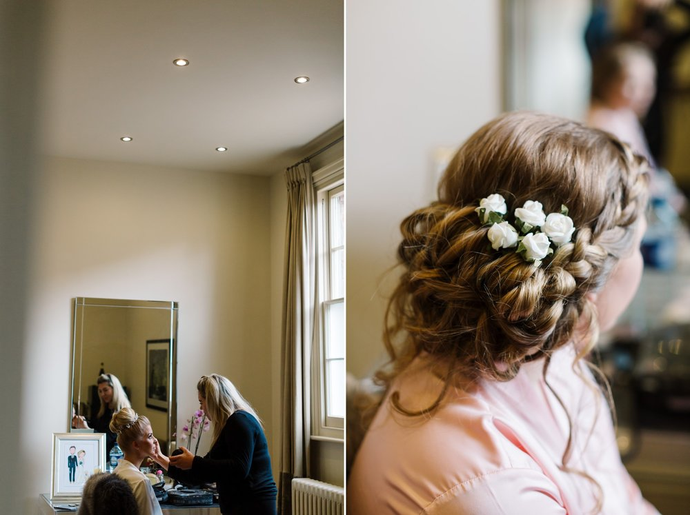 bride and bridesmaid getting ready at braxted park