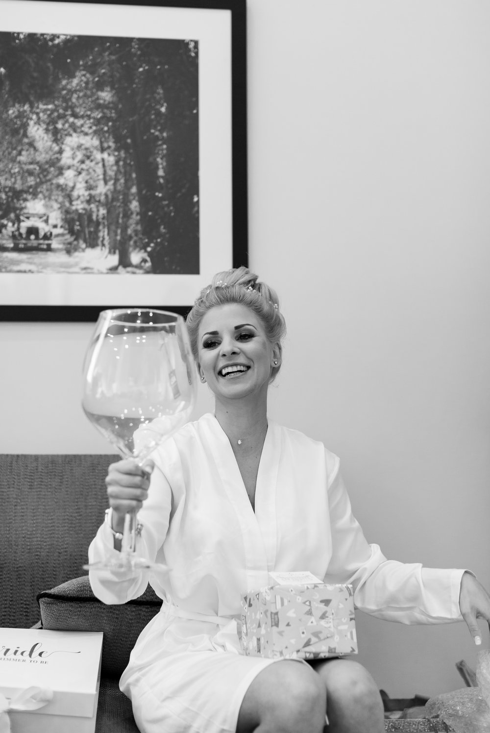 bride holding massive wine glass