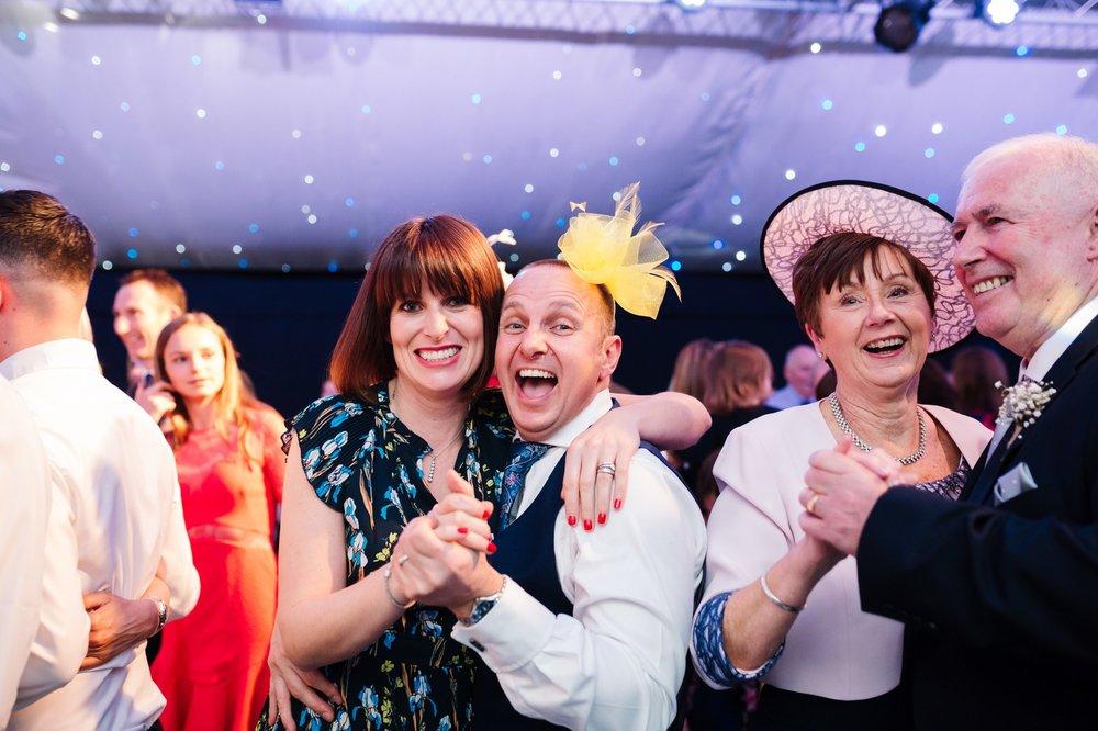 husband and wife dancing at fun wedding