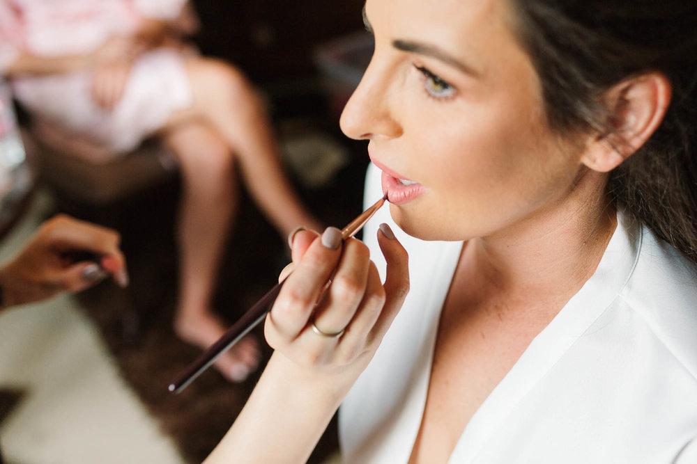 bride having lipstick done