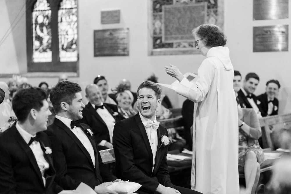 groom laughing with best men in church