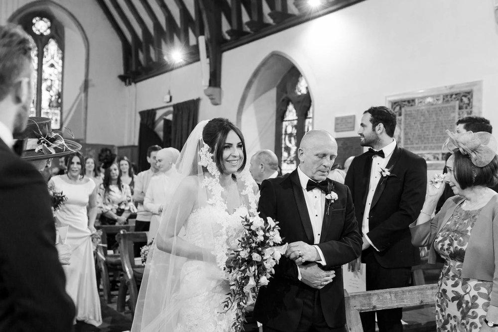 bride walking down aisle - elegant and stylish wedding
