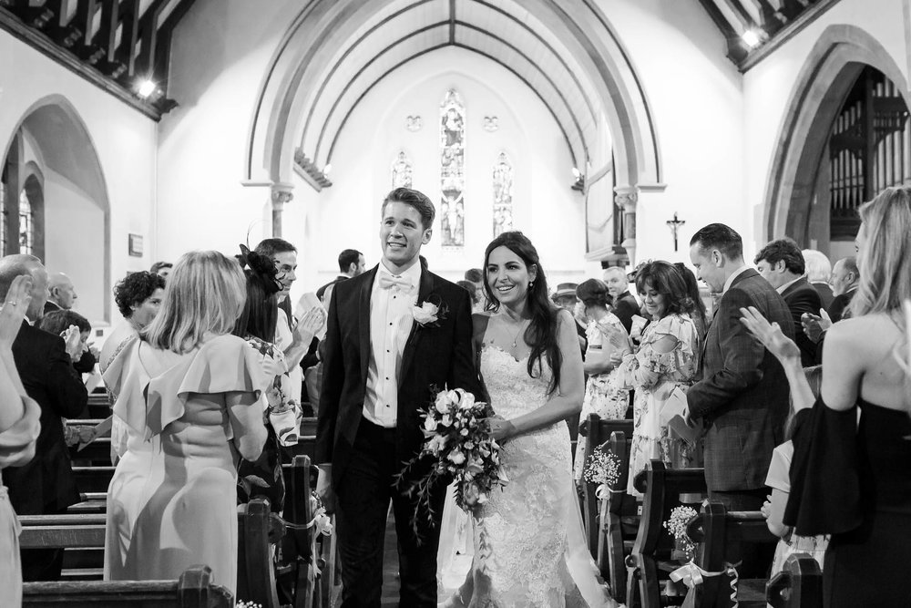 bride and groom walking down aisle - elegant and stylish wedding