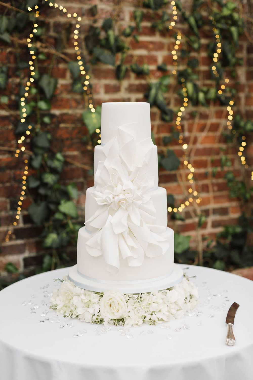 white 4 tier wedding cake