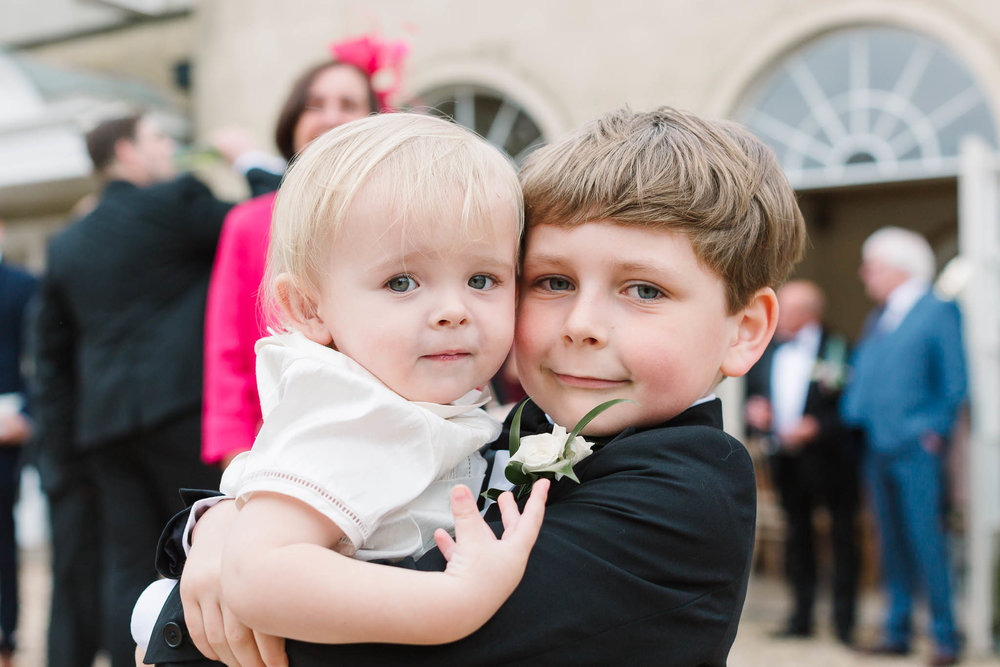 two boys cuddling at wedding
