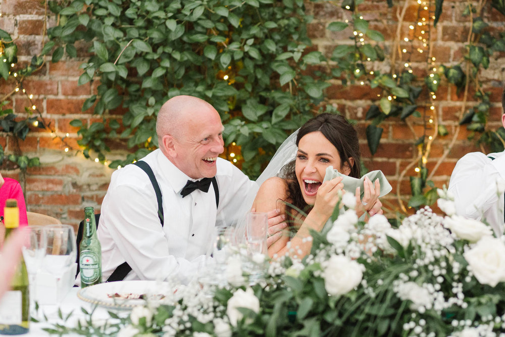 bride embarrassed with dad during speeches