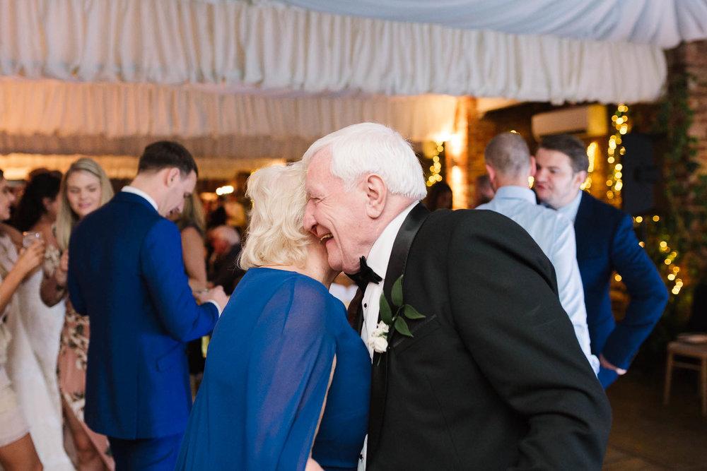grandparents dancing at wedding