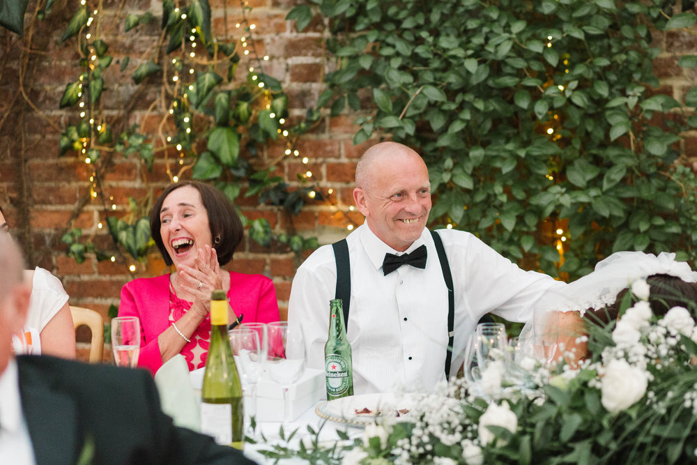 parents laughing at speeches - elegant and stylish wedding
