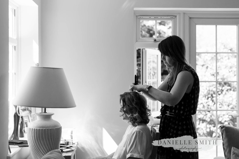 bride having her hair done- elegant and romantic black tie wedding