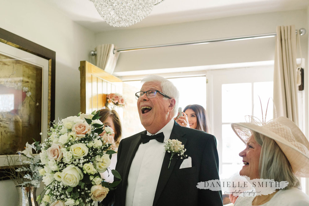 dad seeing bride in her dress