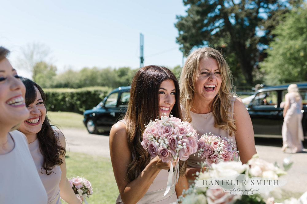 excited bridesmaids before ceremony