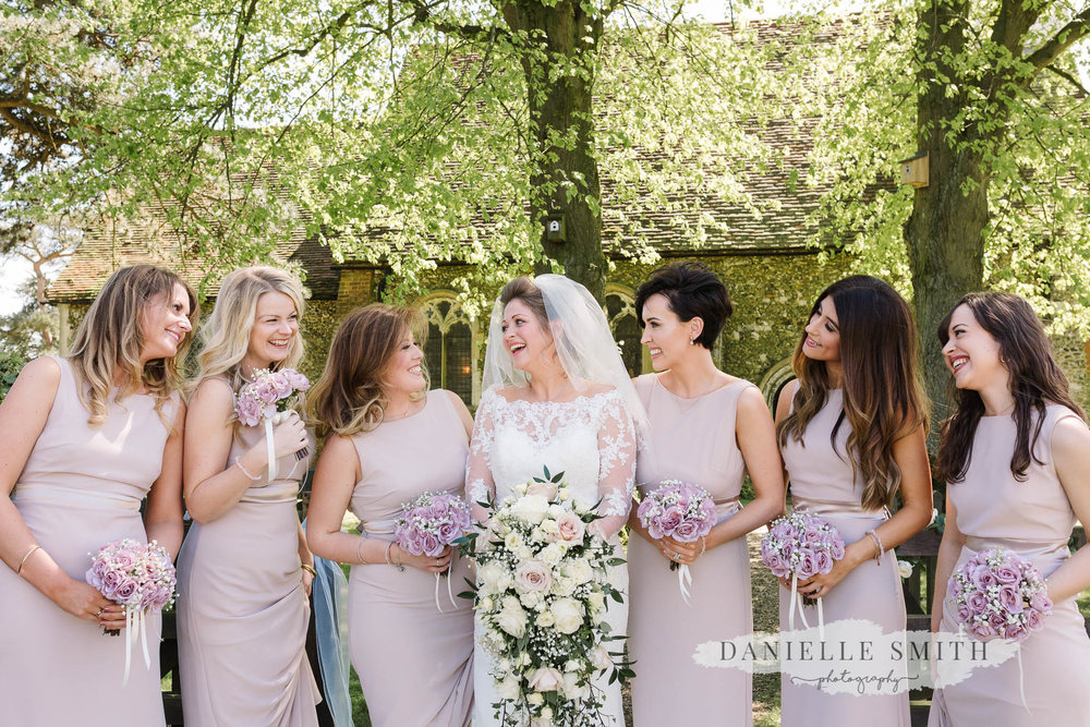 bridesmaids in lilac dresses and flowers