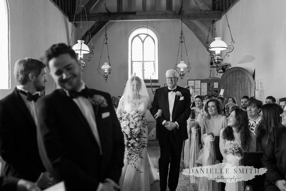 dad giving away his daughter - elegant and romantic black tie wedding
