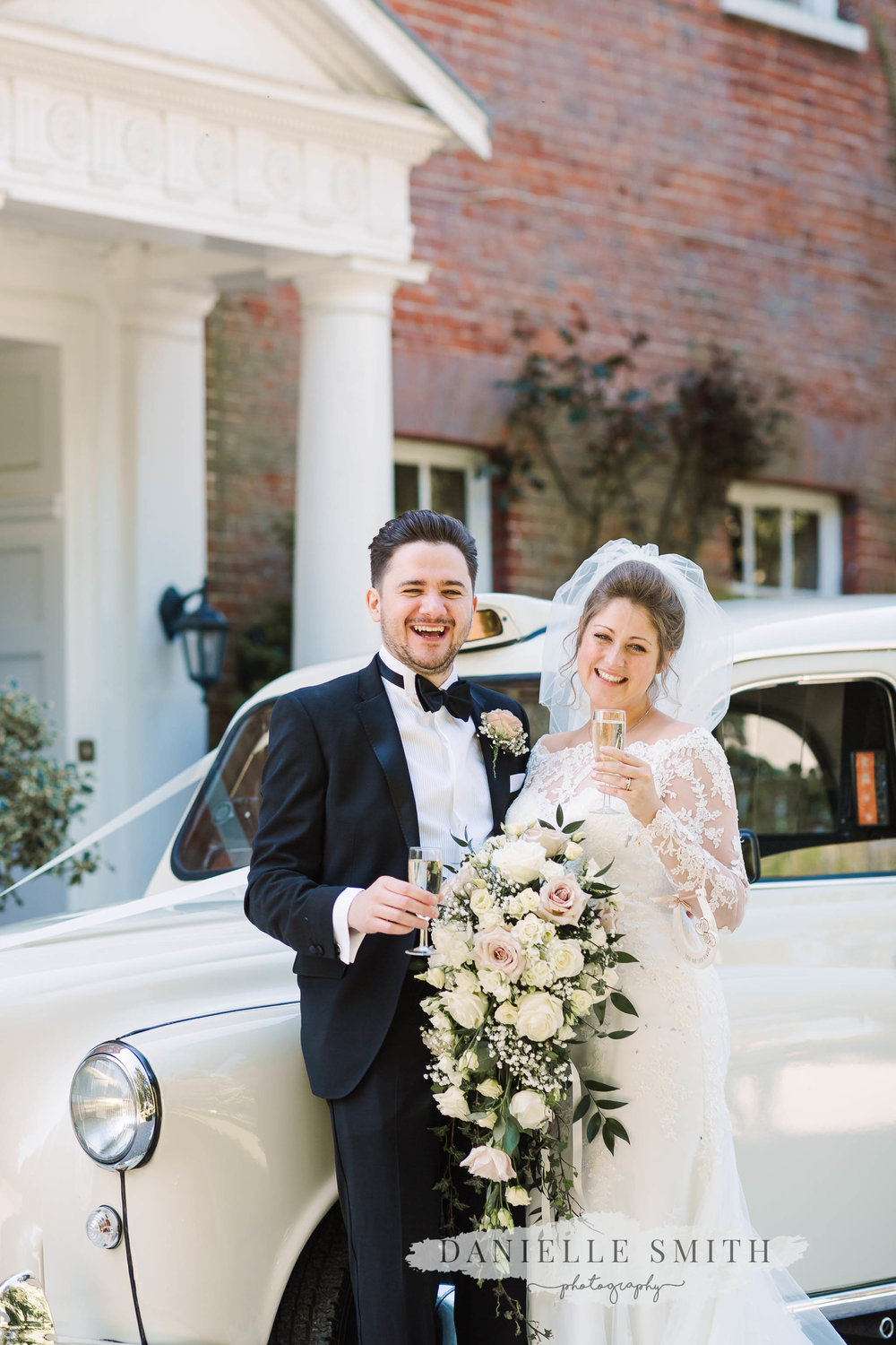 bride and groom with champagne and white taxi - elegant and romantic black tie wedding