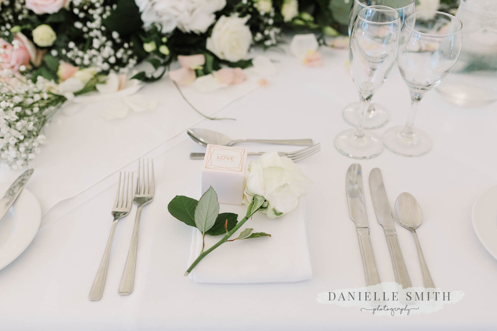 table set up with white rose
