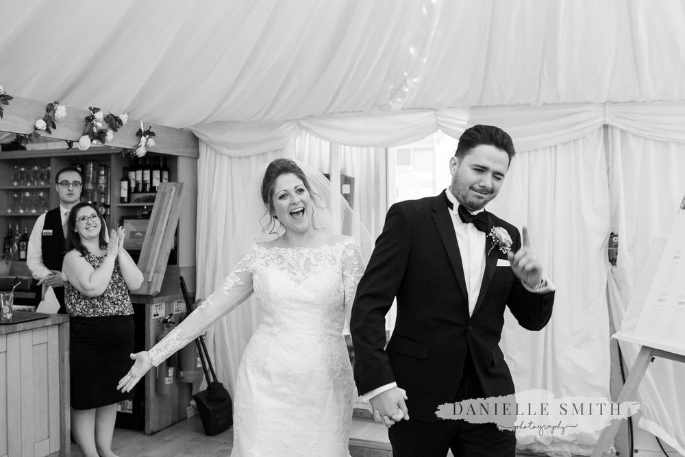 bride and groom entering room - elegant and romantic black tie wedding at mulberry house