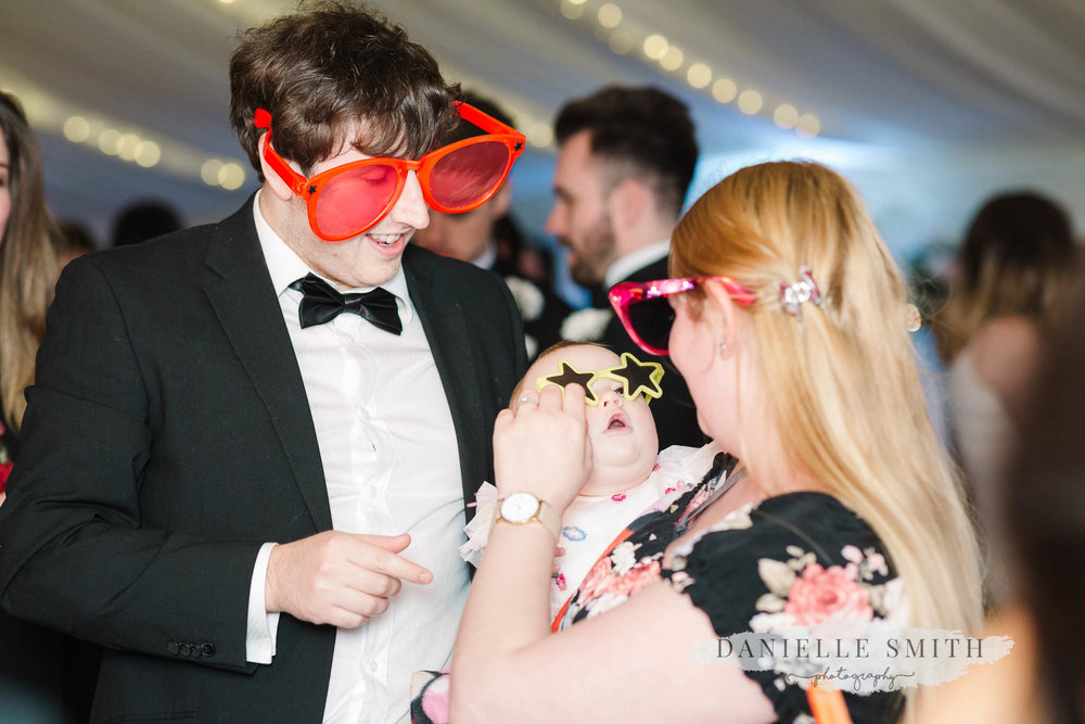 wedding guests wearing photo booth props
