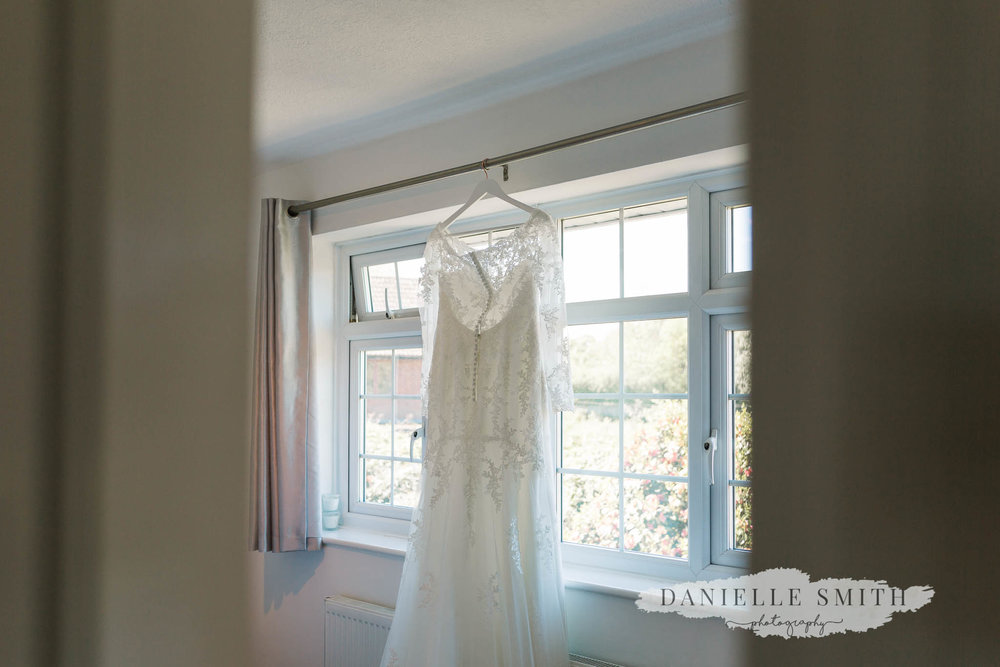stella york wedding dress hanging