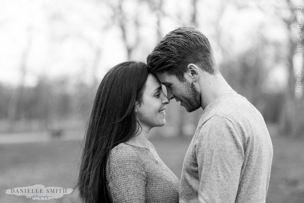 couple touching heads in kensington gardens