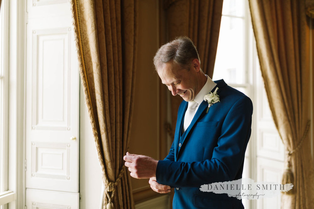groom doing his cufflinks at hylands house