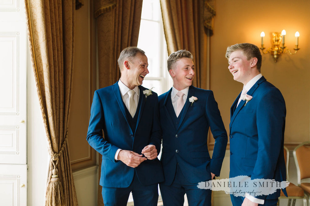 groom and best men laughing