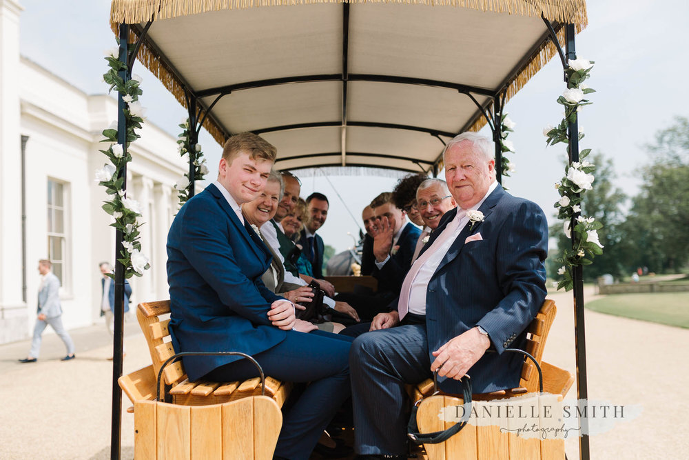 wedding guests on horse and carriage ride