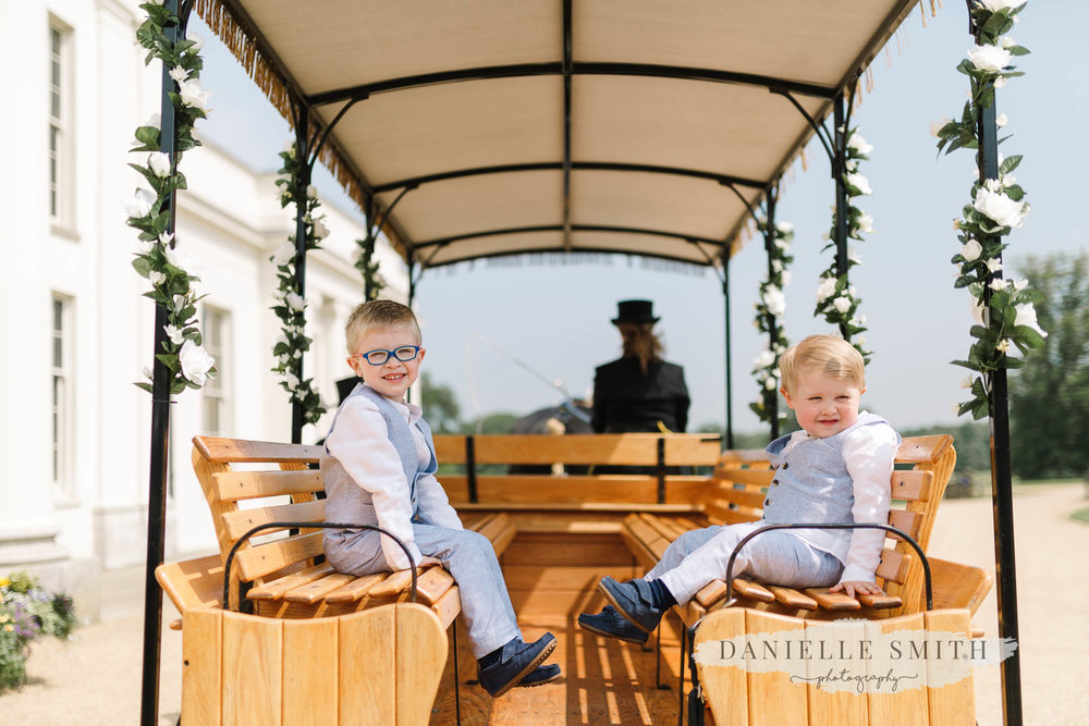page boys on horse and carriage ride