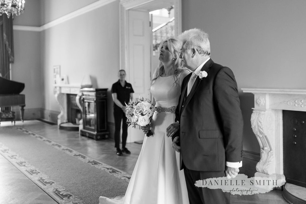 bride and dad getting teary before walk down aisle