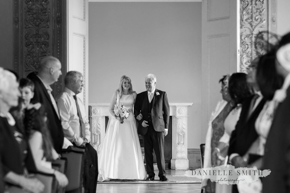 bride and dad laughing before walk down aisle