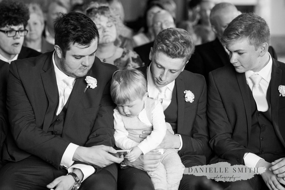 page boy and groomsmen sitting together