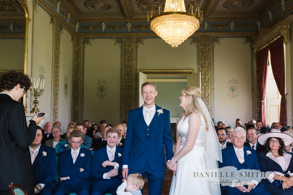 bride and groom laughing during ceremony at hylands house