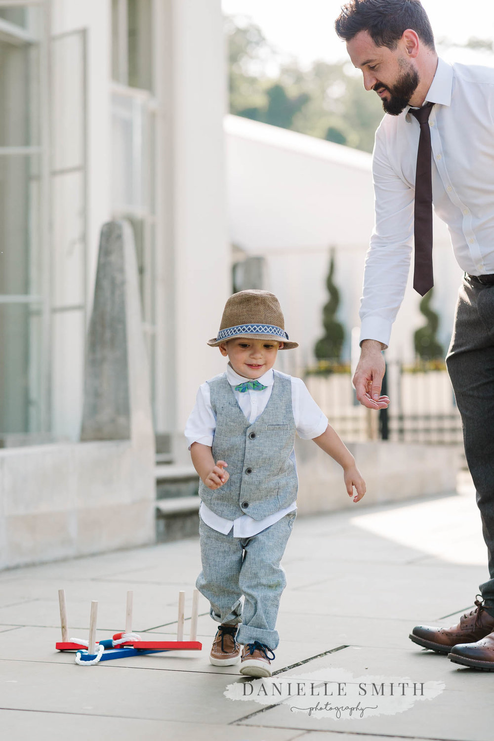 little boy with dad at wedding
