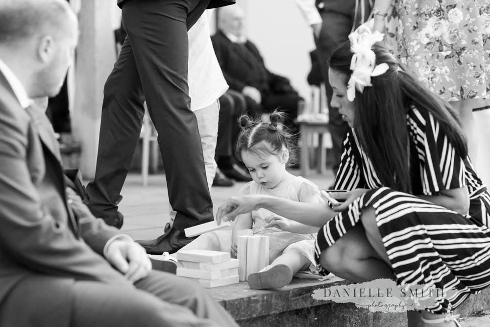little girl playing with jenga