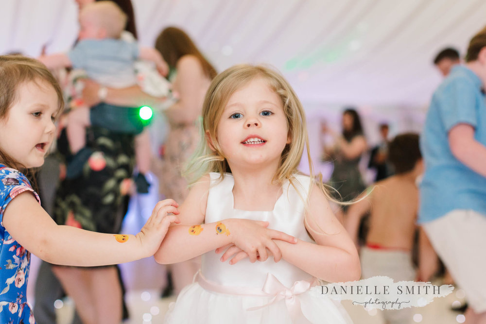 flower girl smiling on dance floor