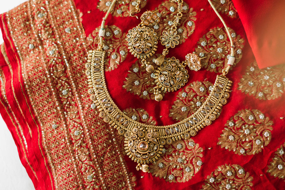 red and gold sari and jewellery