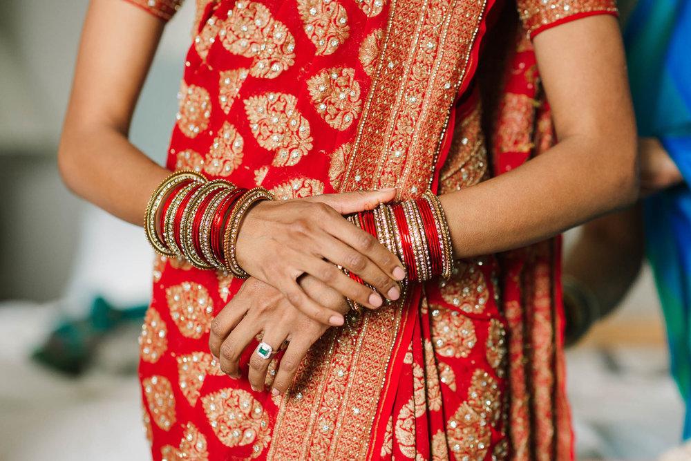 red and gold sari and bangles