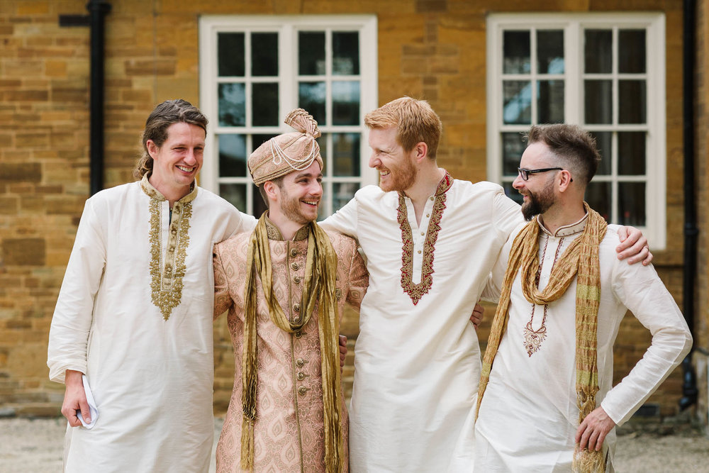 groom and ushers dressed in Indian wedding outfits