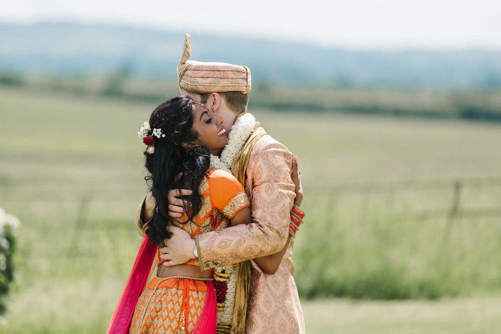 indina bride and groom hugging