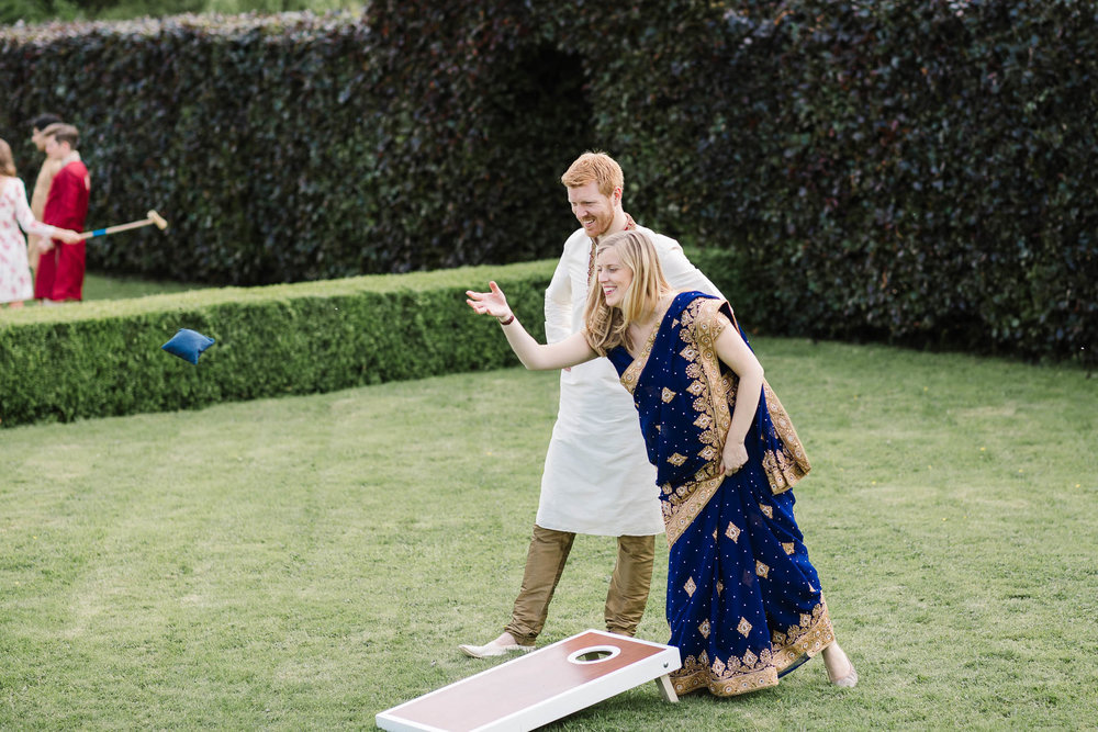 couple playing garden games at wedding