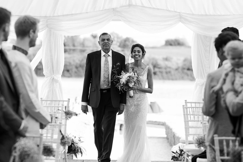 father walking daughter down aisle at Poundon House