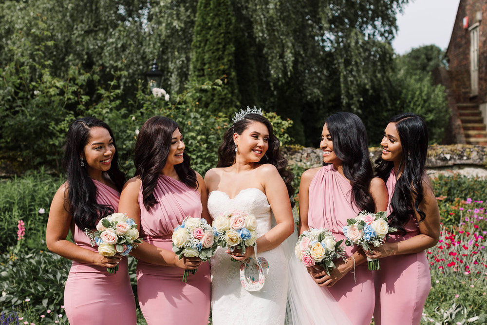 bride and her bridesmaids in pink dresses