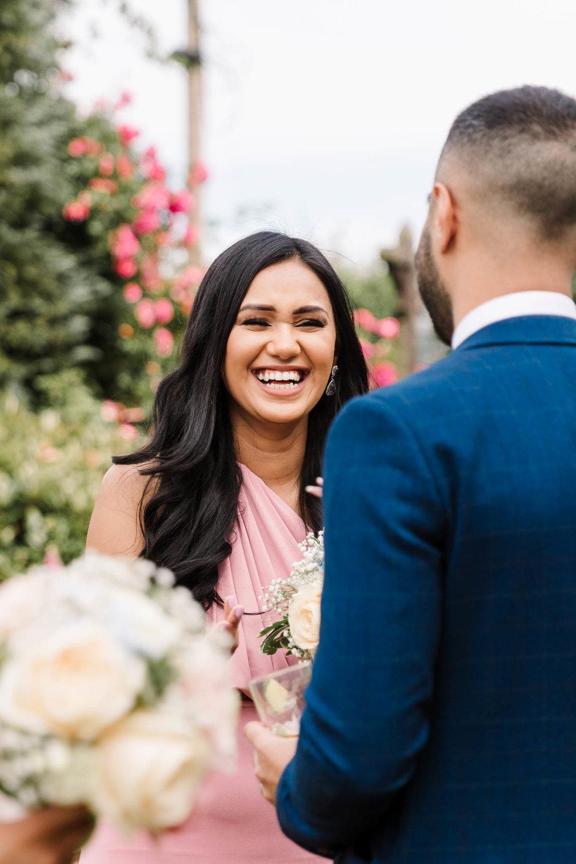 bridesmaid laughing at fun and relaxed wedding