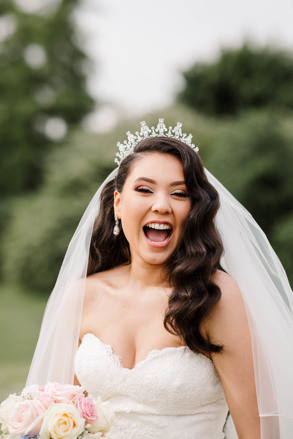 bride laughing at fun and relaxed summer wedding