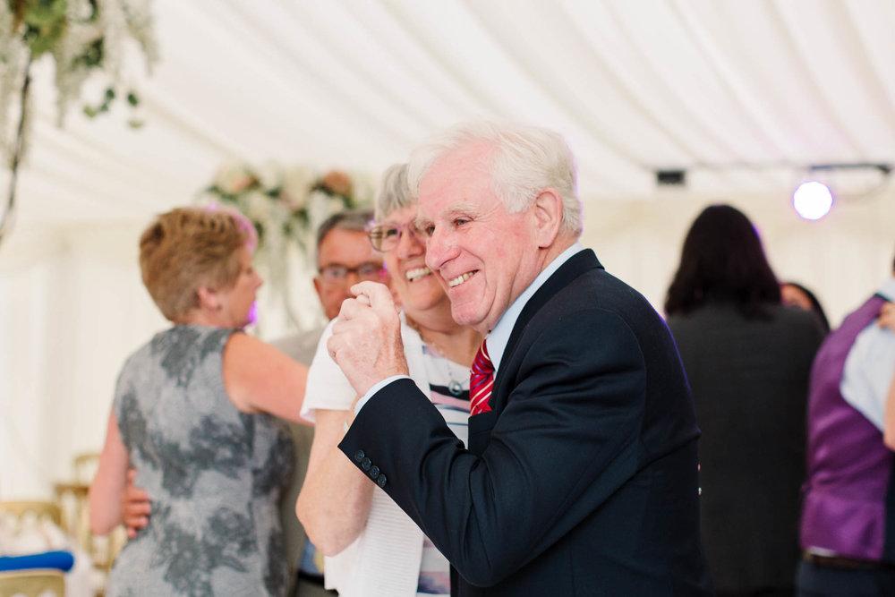 older guests dancing at wedding