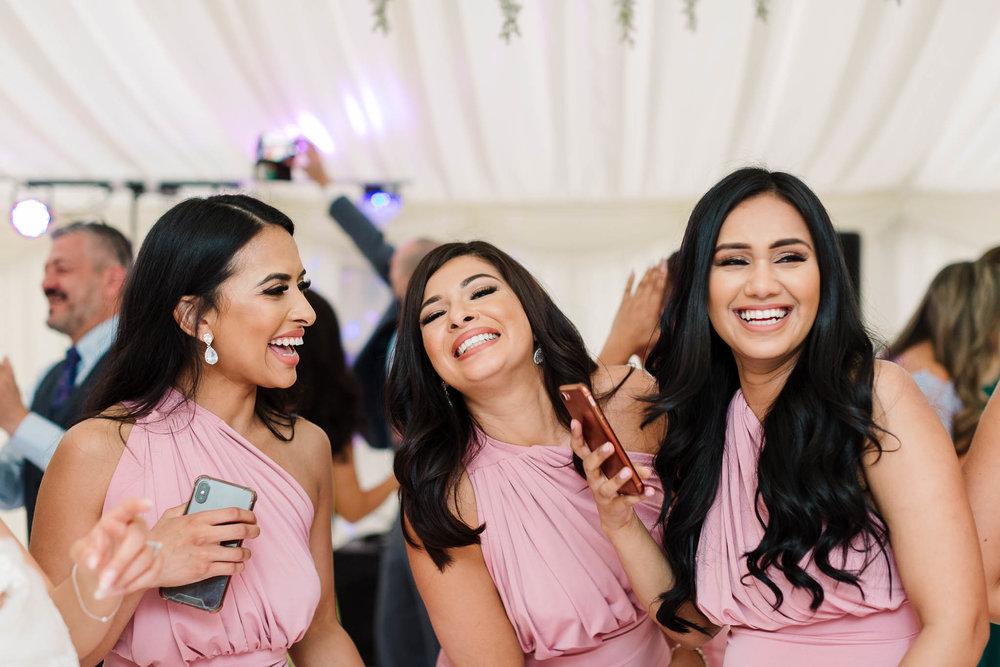 bridesmaids laughing on dancefloor