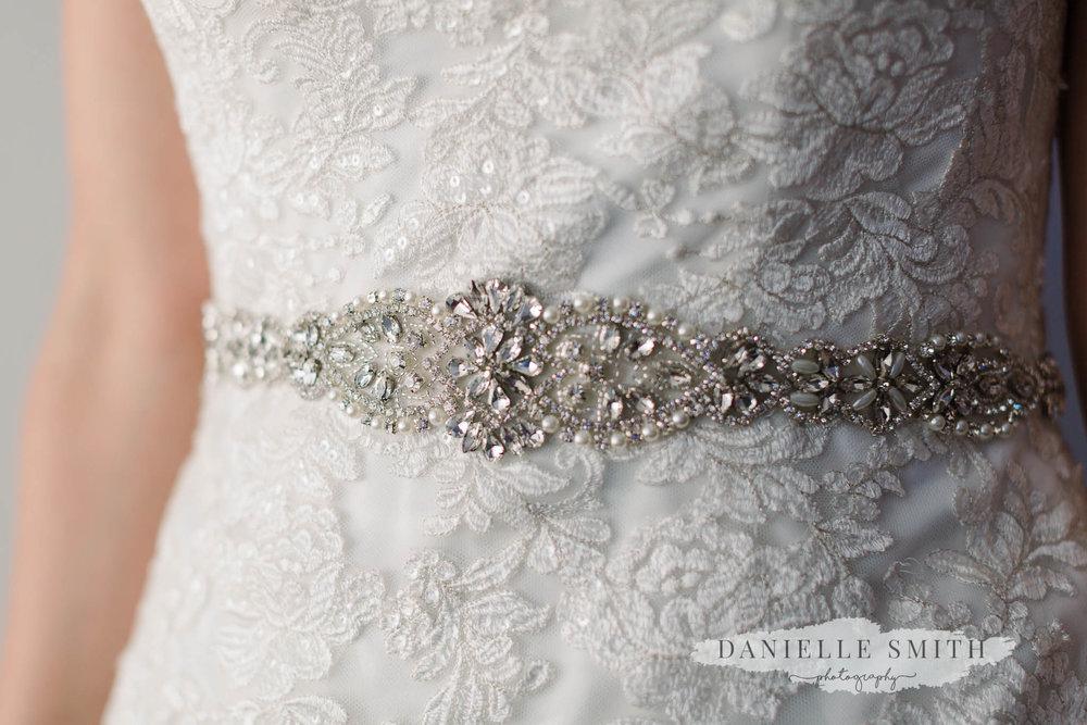 embellished belt on wedding dress