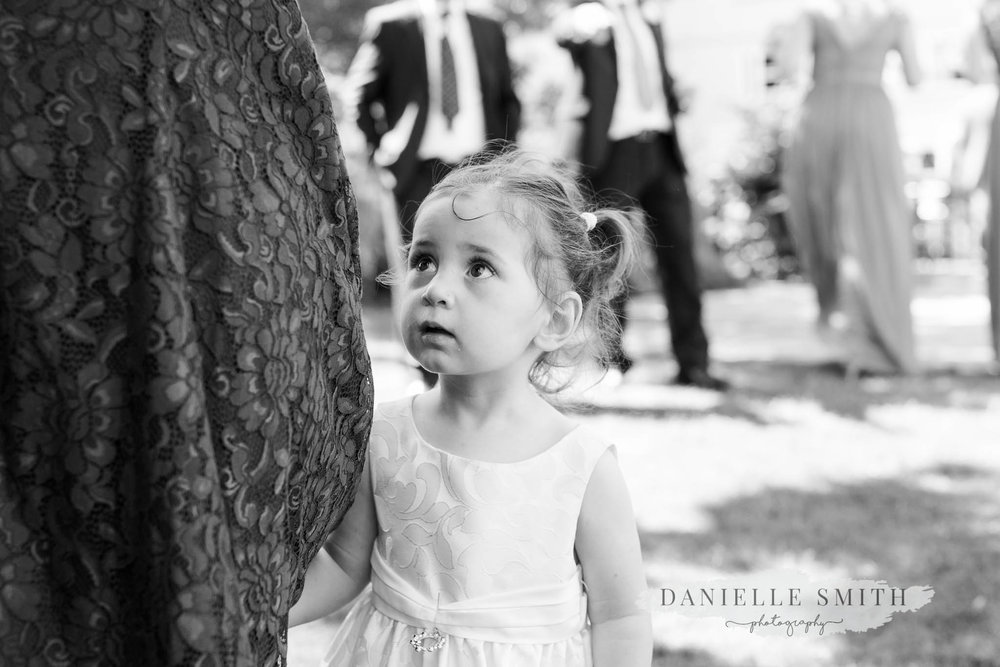 little girl at chilled turkish-english wedding
