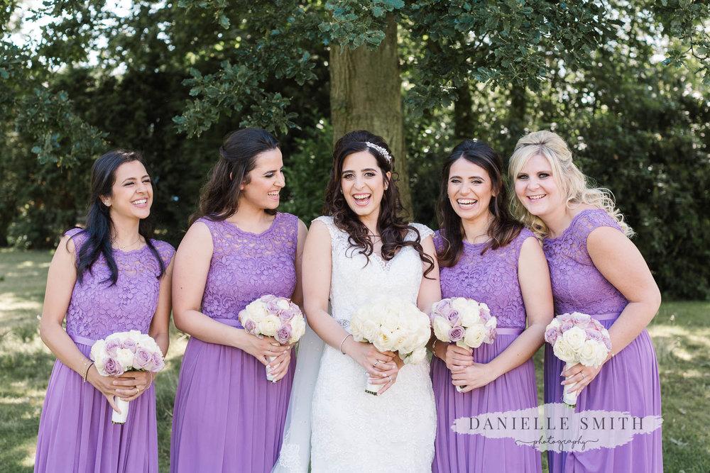 bride and bridesmaids laughing at Sopwell Hosue